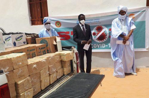 Article : Covid-19,  l'UNFPA offre aux membres du Forum de la Pensée Islamique des produits désinfectants
